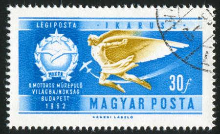 icarus: HUNGARY – CIRCA 1962: stamp printed by Hungary, shows Icarus and Aero Club emblem, circa 1962