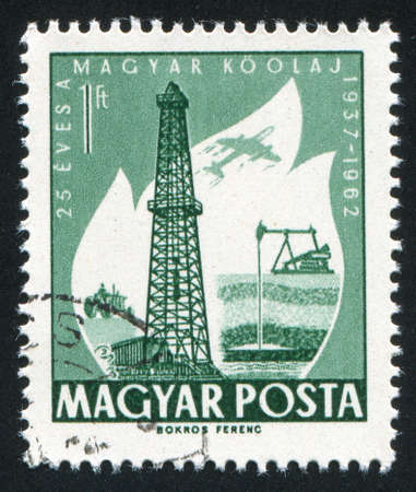 HUNGARY – CIRCA 1962: stamp printed by Hungary, shows Oil Derrick and Primitive Oil well, circa 1962 photo
