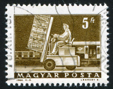 HUNGARY  CIRCA 1964: stamp printed by Hungary, shows Hydraulic lift truck and  mail car, circa 1964 Stock Photo - 12394645
