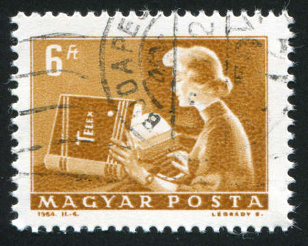 catenation: HUNGARY  CIRCA 1964: stamp printed by Hungary, shows woman teletypist, circa 1964