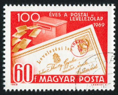 rewriting: HUNGARY – CIRCA 1969: stamp printed by Hungary, shows postcard and mail box, circa 1969