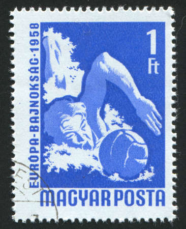 HUNGARY  CIRCA 1958: stamp printed by Hungary, shows water polo player, circa 1958 photo