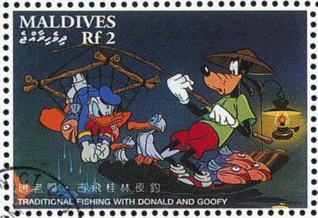 MALDIVE ISLANDS - CIRCA 1996: stamp printed by Maldive Islands, shows Traditional fishing with Donald, Goofy, circa 1996
