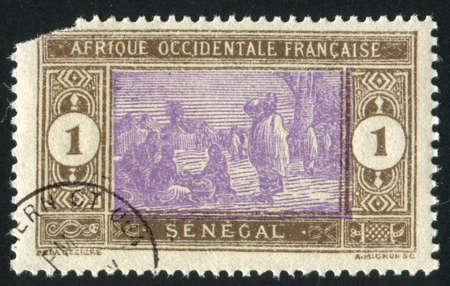 SENEGAL - CIRCA 1914: stamp printed by Senegal, shows Senegalese Preparing Food, circa 1914 photo