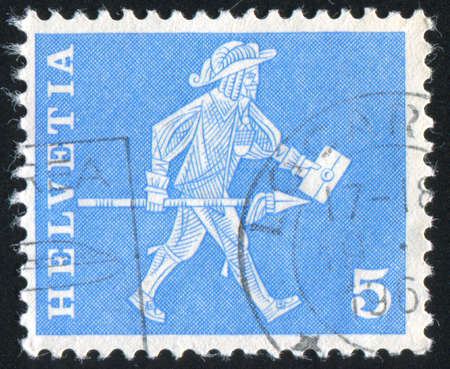 jackboots: SWITZERLAND - CIRCA 1961: stamp printed by Switzerland, shows Messenger, circa 1961 Stock Photo