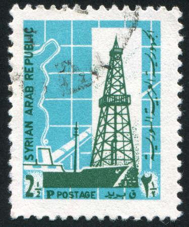 wheelhouse: SYRIA - CIRCA 1968: stamp printed by Syria, shows Oil Derrick and Pipe Line, circa 1968 Stock Photo
