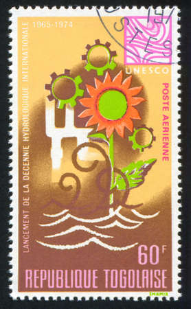water cycle: TOGO - CIRCA 1968: stamp printed by Togo, shows Water Cycle, Flower and Cogwheels, circa 1968 Editorial