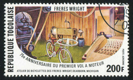 TOGO - CIRCA 1978: stamp printed by Togo, shows Wrights' bicycle shop, circa 1978