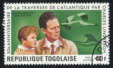 TOGO - CIRCA 1977: stamp printed by Togo, shows Lindbergh and son, birds, circa 1977 Stock Photo - 12354668