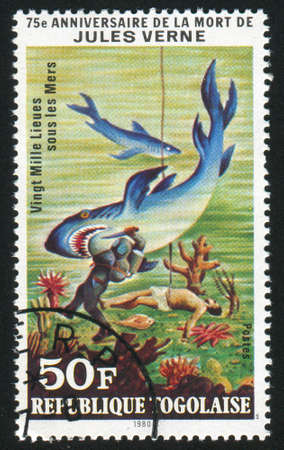 raptorial: TOGO - CIRCA 1980: stamp printed by Togo, shows 20,000 Leagues Under the Sea, Jules Verne, circa 1980