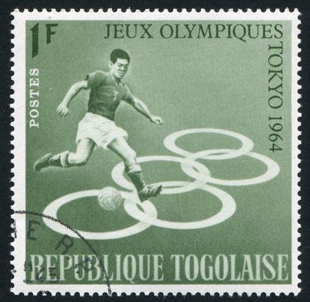 deportes olimpicos: TOGO - CIRCA 1964: sello impreso por Togo, muestra de fútbol, ??alrededor del año 1964 Editorial