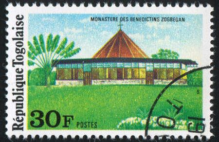 gabled: TOGO - CIRCA 1975: stamp printed by Togo, shows Benedictine Monastery, Zogbegan, circa 1975