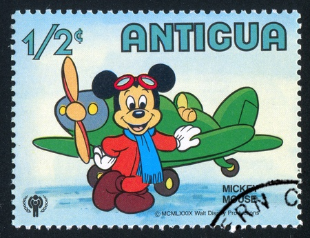ANTIGUA - CIRCA 1980: stamp printed by Antigua, shows Disney Characters, Mickey mouse, plane, circa 1980