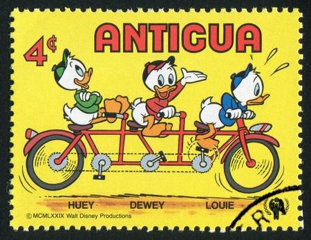 dewey: ANTIGUA - CIRCA 1980: stamp printed by Antigua, shows Disney Characters, Huey, Dewey and Louie, circa 1980