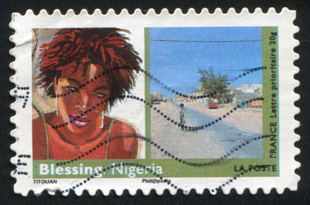 FRANCE - CIRCA 2009: stamp printed by France, shows  Art, Woman, Blessing (Nigeria), circa 2009