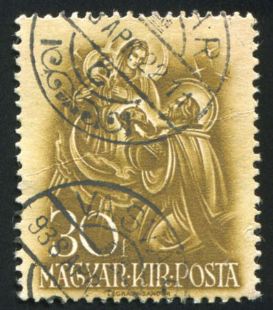 HUNGARY - CIRCA 1937: stamp printed by Hungary, shows Saint Spephen offering holy crown to Virgin Mary, circa 1937 photo
