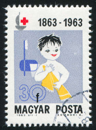 HUNGARY – CIRCA 1963: stamp printed by Hungary, shows Child with medicines,  circa 1963