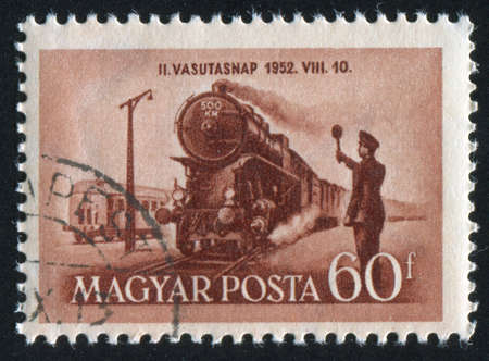 HUNGARY – CIRCA 1952: stamp printed by Hungary, shows approaching train, circa 1952