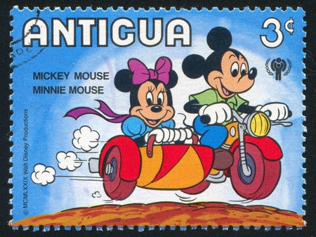 ANTIGUA - CIRCA 1980: stamp printed by Antigua, shows Disney Characters, Minnie in sidecar, circa 1980