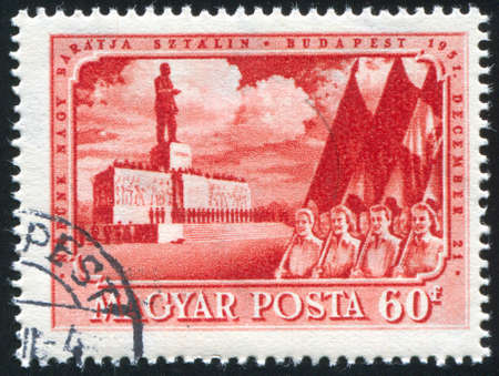 marchers: HUNGARY - CIRCA 1951: stamp printed by Hungary, shows marchers passing Stalin monument, circa 1951