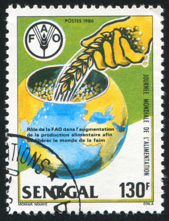 SENEGAL - CIRCA 1986: stamp printed by Senegal, shows Earth storing grain, circa 1986