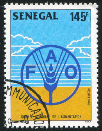 SENEGAL - CIRCA 1986: stamp printed by Senegal, shows Emblem, circa 1986 Stock Photo - 12578501
