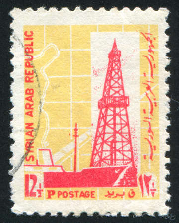SYRIA - CIRCA 1968: stamp printed by Syria, shows Oil Derrick and Pipe Line, circa 1968 photo