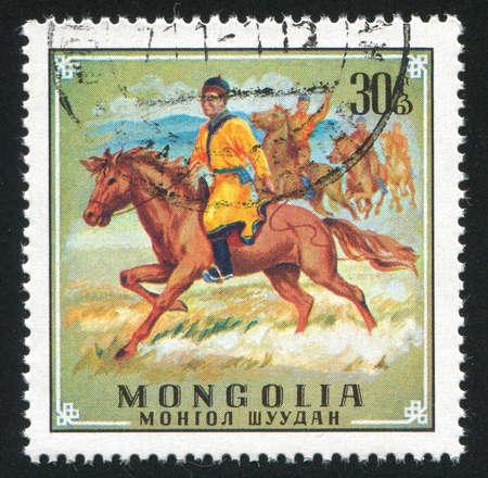 charro: MONGOLIA - CIRCA 1970: sello impreso por Mongolia, muestra jinete, alrededor de 1970