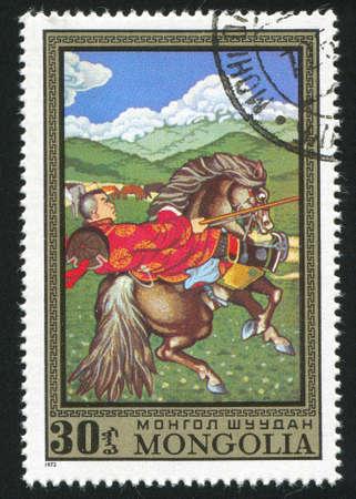 MONGOLIA - CIRCA 1972: stamp printed by Mongolia, lancer on horseback, circa 1972 Stock Photo - 12594111