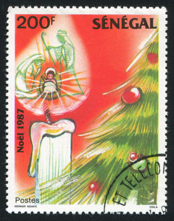 SENEGAL - CIRCA 1987: stamp printed by Senegal, shows Holy Family, candle and Christmas tree, circa 1987 photo