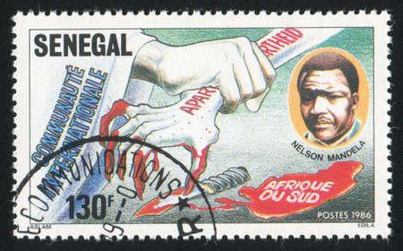 african solidarity: SENEGAL - CIRCA 1987: stamp printed by Senegal, shows Solidarity Against South African Apartheid, circa 1987 Editorial