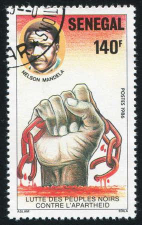 SENEGAL - CIRCA 1987: stamp printed by Senegal, shows Mandela, hand, broken chain, circa 1987