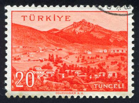 TURKEY - CIRCA 1959: stamp printed by Turkey, shows Turkish city, Tunceli, circa 1959. photo