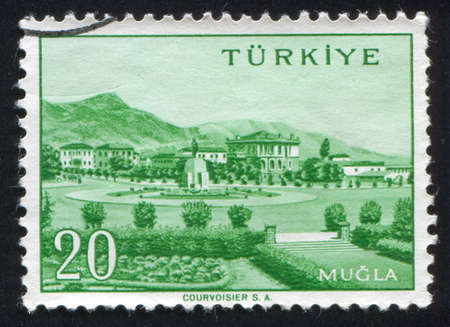 TURKEY - CIRCA 1959: stamp printed by Turkey, shows Turkish city, Mugla, circa 1959. photo