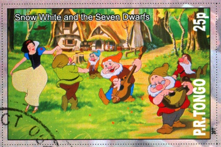 seven dwarfs: TONGO - CIRCA 2011: stamp printed by Tongo, shows Walt Disney cartoon character, Snow White and the Seven Dwarfs, circa 2011