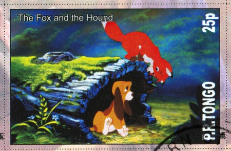 TONGO - CIRCA 2011: stamp printed by Tongo, shows Walt Disney cartoon character, fox and the hound, circa 2011