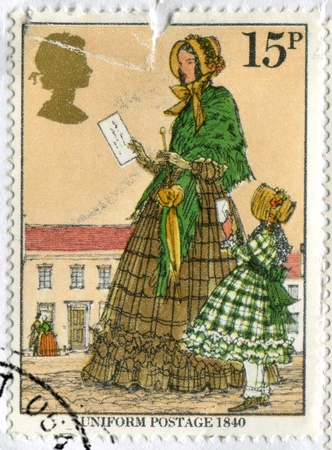 GREAT BRITAIN - CIRCA 1979: stamp printed by Great Britain, shows Victorian woman and child mailing letter, circa 1979 photo