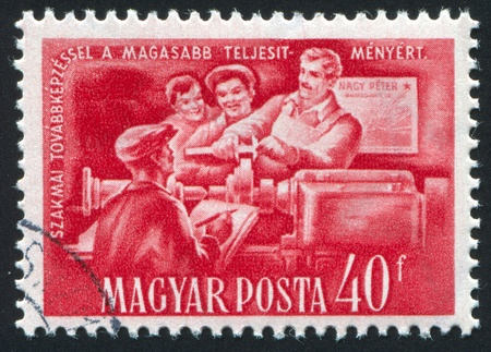 HUNGARY- CIRCA 1951: stamp printed by Hungary, shows checking lather work, circa 1951 photo