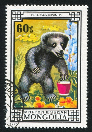 MONGOLIA - CIRCA 1974: stamp printed by Mongolia, shows Sloth bear, circa 1974 photo