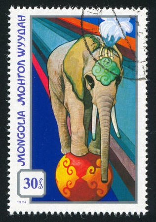 trained: MONGOLIA - CIRCA 1974: stamp printed by Mongolia, shows trained elephant, circa 1974 Stock Photo