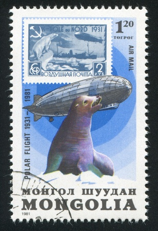 graf: MONGOLIA - CIRCA 1981: stamp printed by Mongolia, shows  Graf Zeppelin and seal, circa 1981 Stock Photo