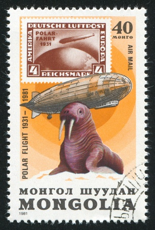 window seal: MONGOLIA - CIRCA 1981: stamp printed by Mongolia, shows  Graf Zeppelin and walrus, circa 1981 Stock Photo