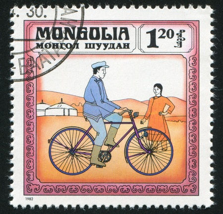 MONGOLIA - CIRCA 1982: stamp printed by Mongolia, shows Man Riding a Bicycle and Woman Looking at Him, circa 1982 photo