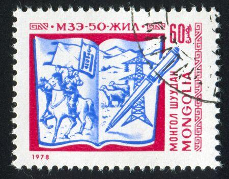 MONGOLIA - CIRCA 1978: stamp printed by Mongolia, shows Open Book and Pen, circa 1978 photo