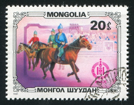 MONGOLIA - CIRCA 1981: stamp printed by Mongolia, shows Horsemen, circa 1981 photo