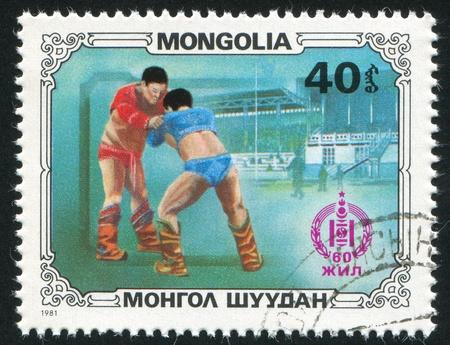 MONGOLIA - CIRCA 1981: stamp printed by Mongolia, shows Wrestlers, circa 1981 photo