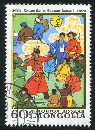 MONGOLIA - CIRCA 1981: stamp printed by Mongolia, shows Mongolian Men, circa 1981 photo