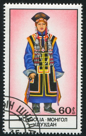 MONGOLIA - CIRCA 1986: stamp printed by Mongolia, shows Woman in National Costume, circa 1986 Stock Photo - 12734528