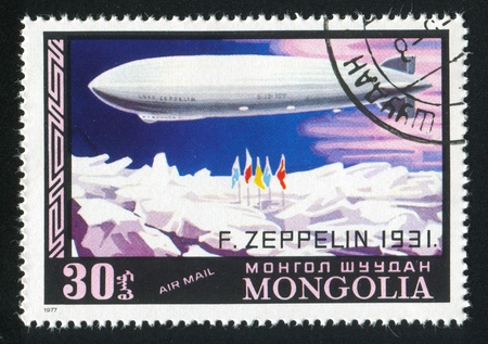 MONGOLIA — CIRCA 1977: stamp printed by Mongolia, shows zeppelin over ice, circa 1977 Stock Photo - 12732951