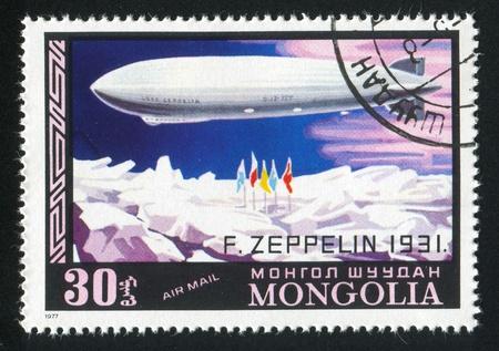 MONGOLIA — CIRCA 1977: stamp printed by Mongolia, shows zeppelin over ice, circa 1977 Stock Photo - 12732951